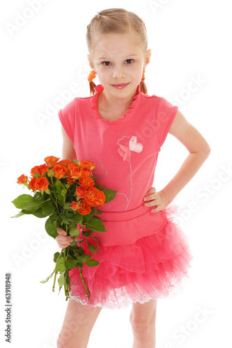 Happy little girl with rose in red clothes