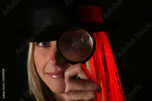 Nice blond female spy with magnifier