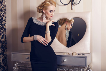 beautiful blond woman in elegant dress with jewellery