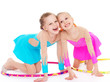 Two pretty little girl doing gymnastics