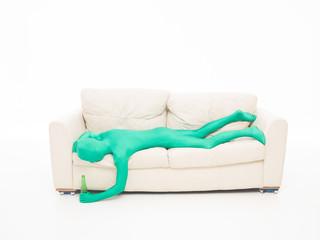 faceless green man felt on coutch
