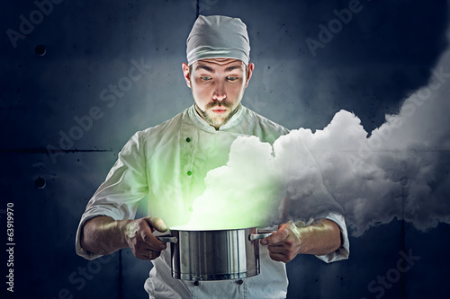 Chef cooking some green stuff - 63919970