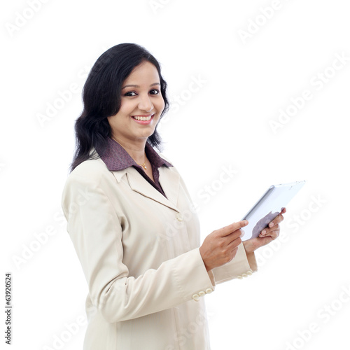 Happy business woman with tablet computer