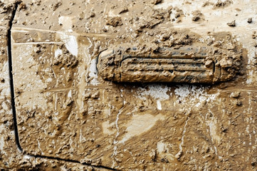 Car door covered in mud