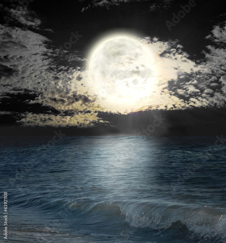 moon reflected in water wavy surface