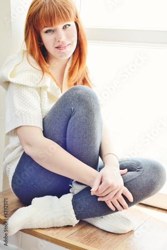resting redhead young woman