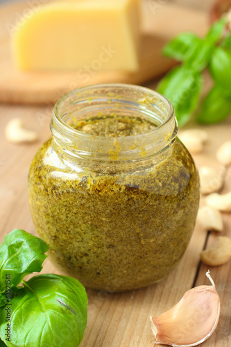 Traditional italian pesto sauce with green basil and cheese