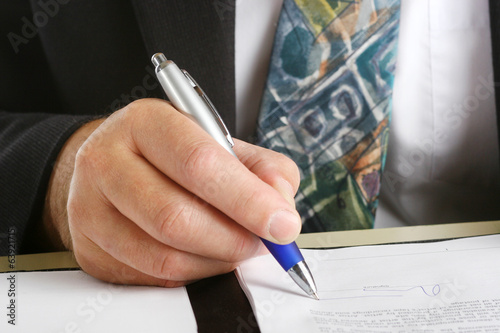Business man siging a contract
