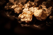 Gold nuggets on black background. - 63921943