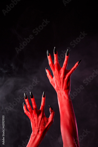 Horror red devil hands with black nails