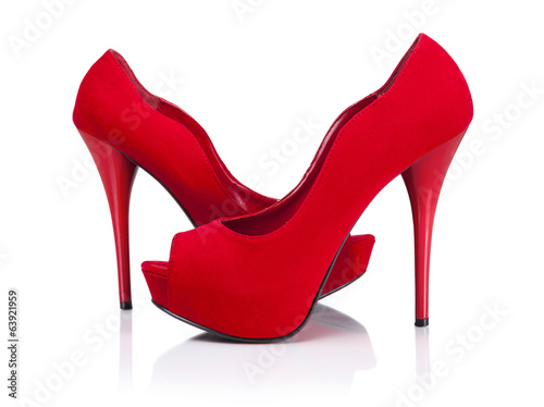 Female red high-heeled shoes over white background.