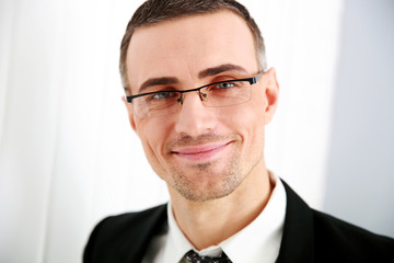Portrait of a smiling businessman in glasses