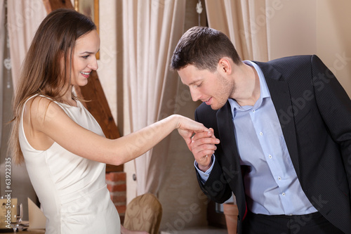 Man kissing his woman's hand