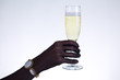 Close-up shot of female hand holding champagne glass