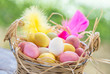 Easter eggs in basket on garden rustic table.Marzipan sweets.