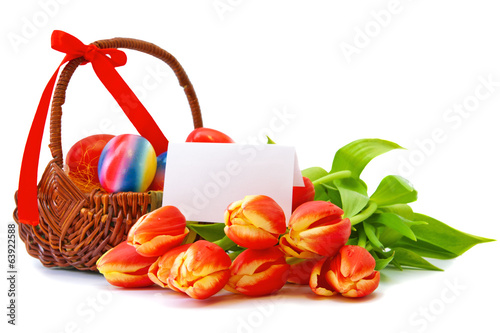 Colorful Easter  eggs and red tulips.