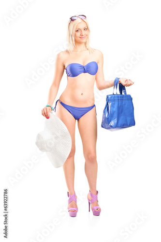 Sexy woman in bikini holding a blue purse