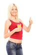 Woman holding an orange juice and giving thumb up