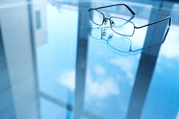 Eyeglasses on reflective surface
