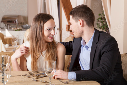 Couple flirting in restaurant