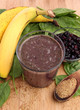 Blueberry smoothie with spinach, bananas and ground flax seeds