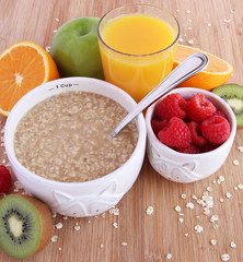 Healthy breakfast of oatmeal, fruit and orange juice