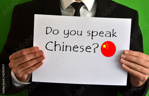 Businessman showing a sheet with text Do you speak Chinese