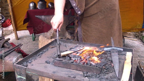 Medieval tradition of making armor and swords at the forge.