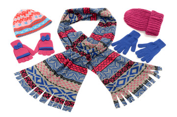 Pink and blue winter accessories isolated.Wool scarf,gloves,hats