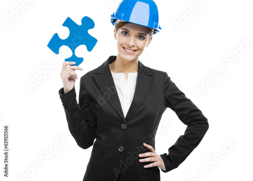 canvas print picture Female engineer with a puzzle piece