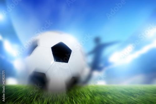 Football, soccer match. A player shooting ball on goal