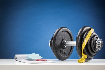 Dumbbell with Measuring Tape and Notebook