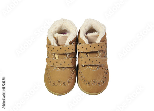 Baby girl's beige boots with fur isolated on white.