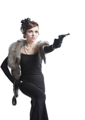 Woman wearing a black dress with gun