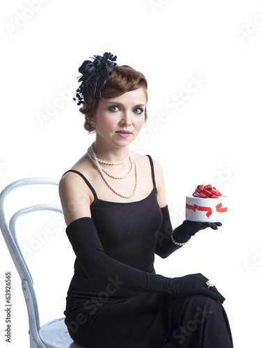 Woman in black dress holding a gift