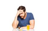 Fototapety Man having in front pills and orange juice
