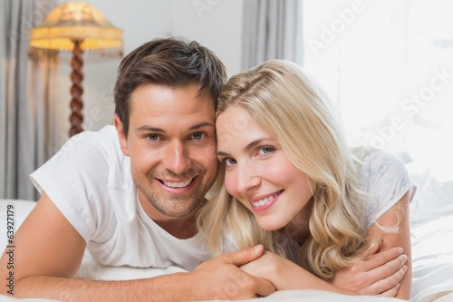 Portrait of a relaxed happy couple resting in bed