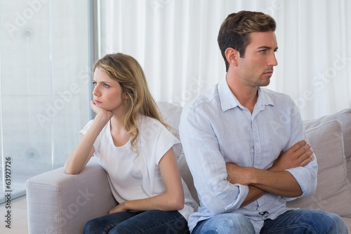 Couple not talking after an argument in living room