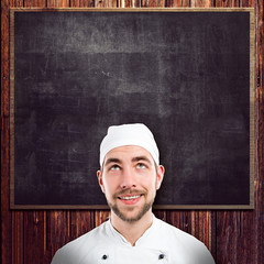 Chef in front of blackboard