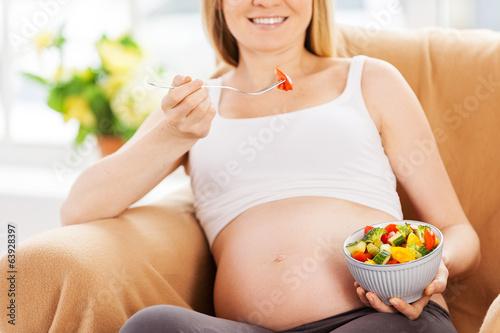 Eating fresh salad.