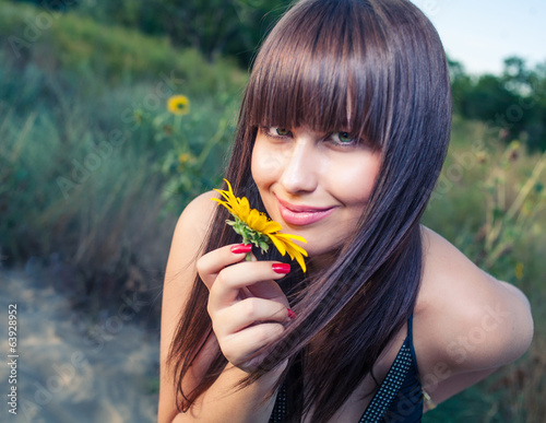Female smelling sunflower