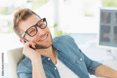 canvas print picture Editor talking on the phone at his desk smiling at camera