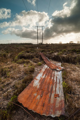discarded rusty corrugated iron in a peat bog field in Ireland