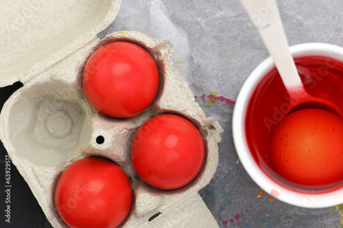 Red Easter eggs and liquid dye