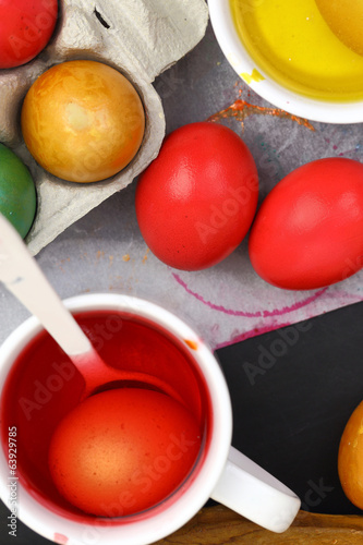 Colored Easter eggs and liquid color dyes