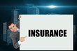 Businessman showing card saying insurance