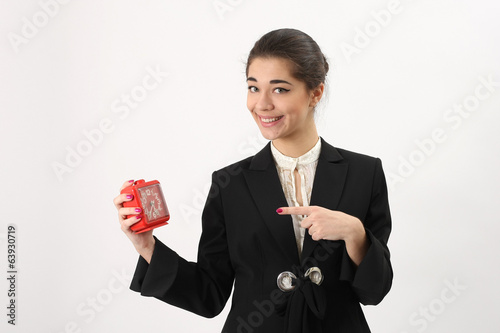 Smiling business woman with alarm in his hand