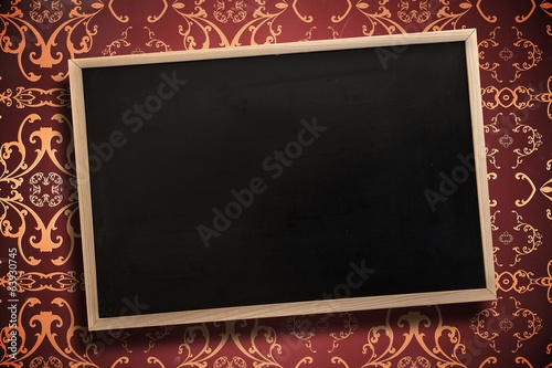 Composite image of chalkboard with wooden frame