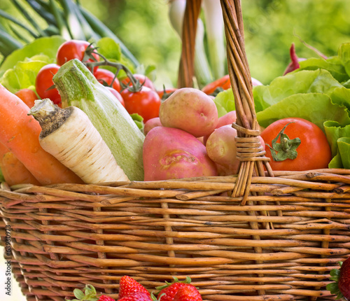 Wicker basket is full with organic vegetables