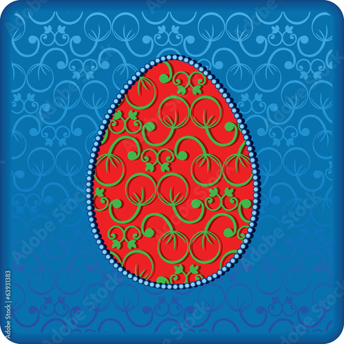 Ornamental red egg on the blue lace backround